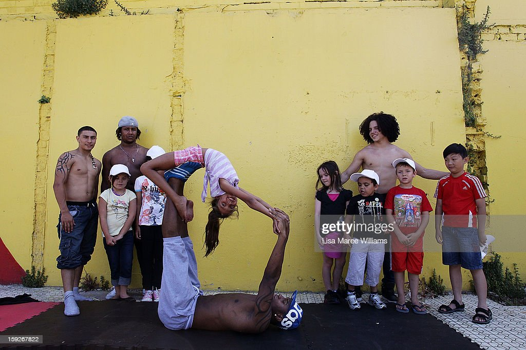 Circolombia circus performers Lil-Louce, Jonathon, Krespo and Yeckly teach Sha-Diamond Smith some moves during a visit to the Redfern Community Centre on January 11, 2013 in Sydney, Australia. The Circolombia performers make up some of the most talented performers of Columbia's national circus school, the first school of its kind for disadvantaged youth. Circolumbia's show, URBAN, begins on January 15 at Riverside Theatre in Parramatta as part of the Sydney Festival .