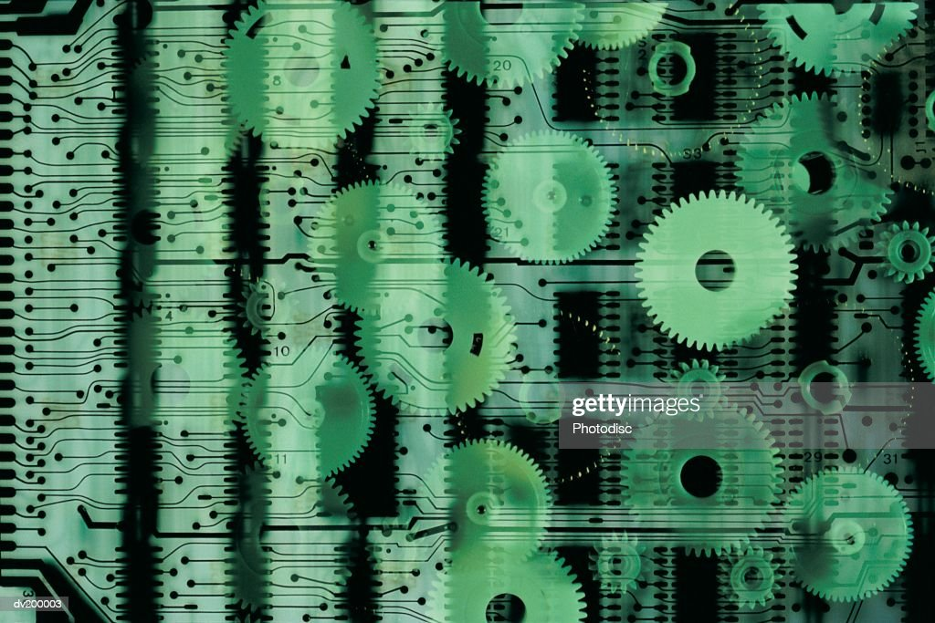 Circuit board and wheels : Stock Photo