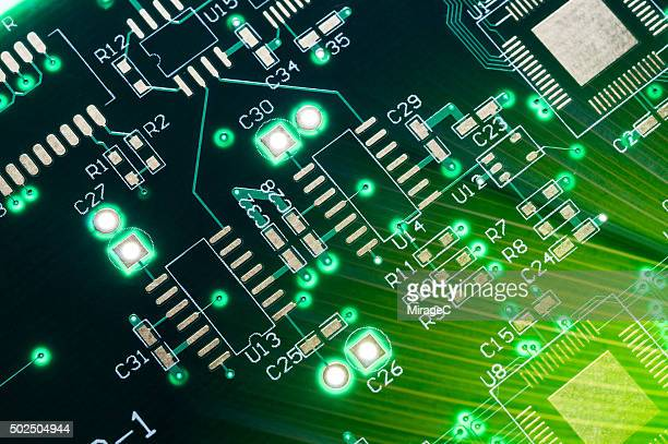 Circuit Board with Green Leaf Close-up View