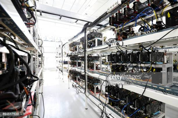 Circuit boards and computer equipment sit on shelves at a cryptocurrency mining facility in Incheon South Korea on Friday Dec 15 2017 Hedge funds are...