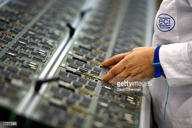 Circuit boards are lined up by an Israeli technician along a production line at an ECI Telecom hightech plant January 15 2003 in Petah Tikva which is...
