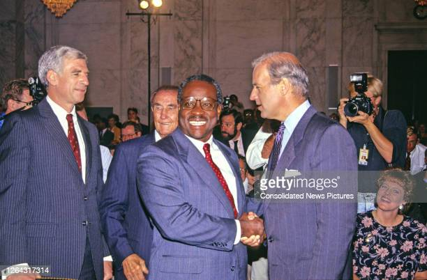 Circuit Court of Appeals Judge Clarence Thomas shakes hands with American politician, US Senator, and Chairman of the Senate Judiciary Committee...