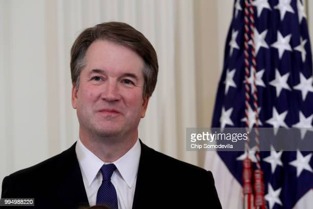 S Circuit Judge Brett M Kavanaugh looks on as US President Donald Trump introduces him as his nominee to the United States Supreme Court during an...