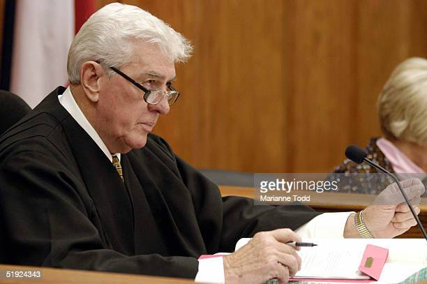 Circuit Judge Marcus Gordon sits on the bench for the arraignment of Edgar Ray Killen for three counts of murder in the 1964 slayings of three civil...