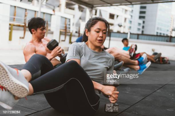 circuit training and healthy lifestyle in asia - asian six pack stock photos and pictures