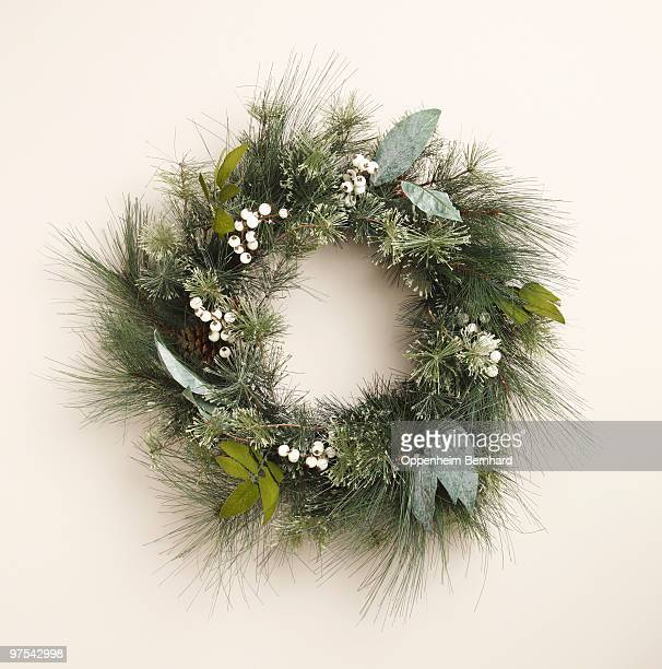circular christmas wreath on plain background