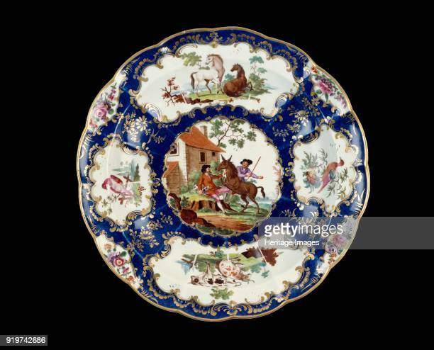 Circular dish 17681770 Gilt edge of sixteen indentations the blue scale ground has two large irregular reserves one decorated with two horses the...