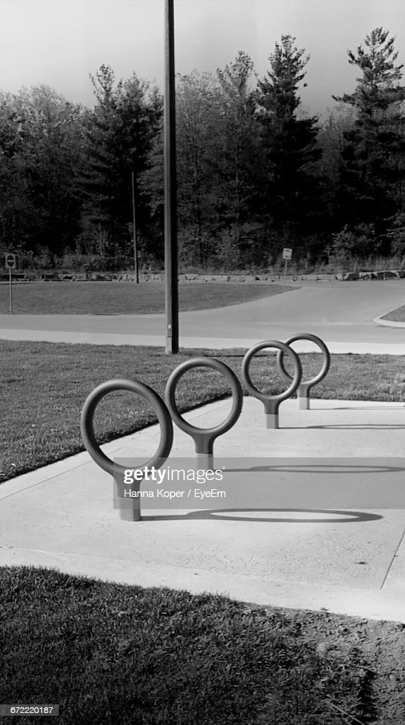 Circular Equipment On Field In Park Against Trees : Stock Photo