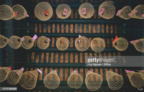 circular incenses in chinese pagoda - incense coils stock photos and pictures