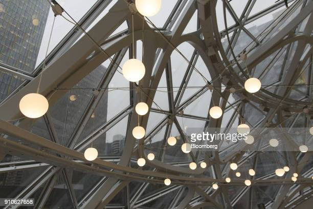 Circular light fixtures hang inside the Amazoncom Inc Spheres in Seattle Washington US on Tuesday Jan 23 2018 The online retailer is scheduled to...