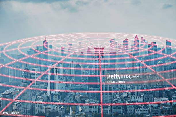 circular light glow streaming out of skyscraper - big tech stock pictures, royalty-free photos & images
