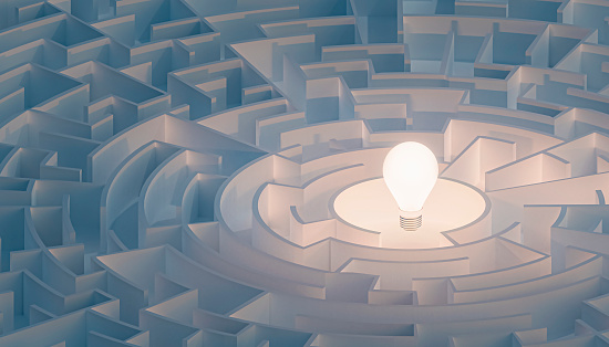 Circular maze or labyrinth with light bulb in its center. Puzzle, riddle, intelligence, thinking, solution, IQ concepts. 3d render illustration. 1151390404