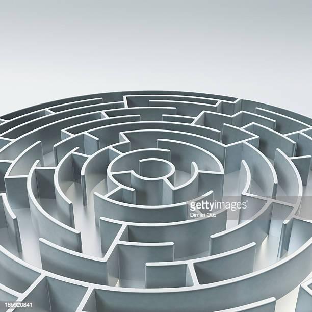 Circular metal maze with text area above