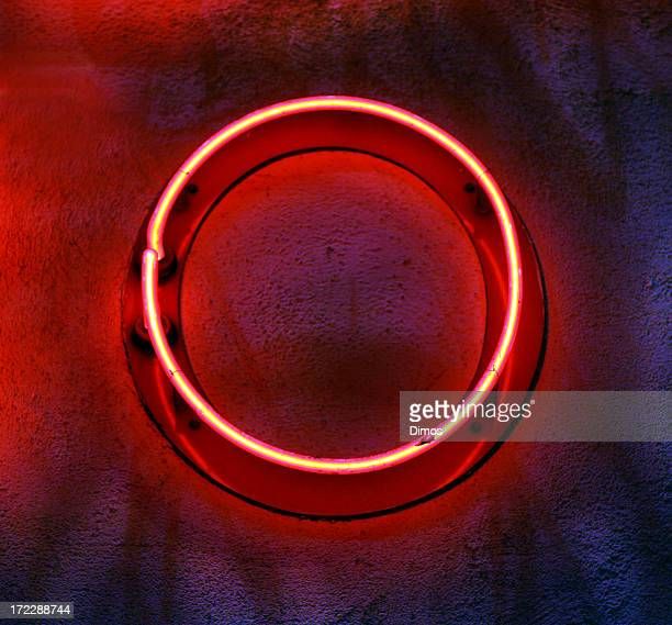 circular neon light mounted on a wall - neon letters stock photos and pictures