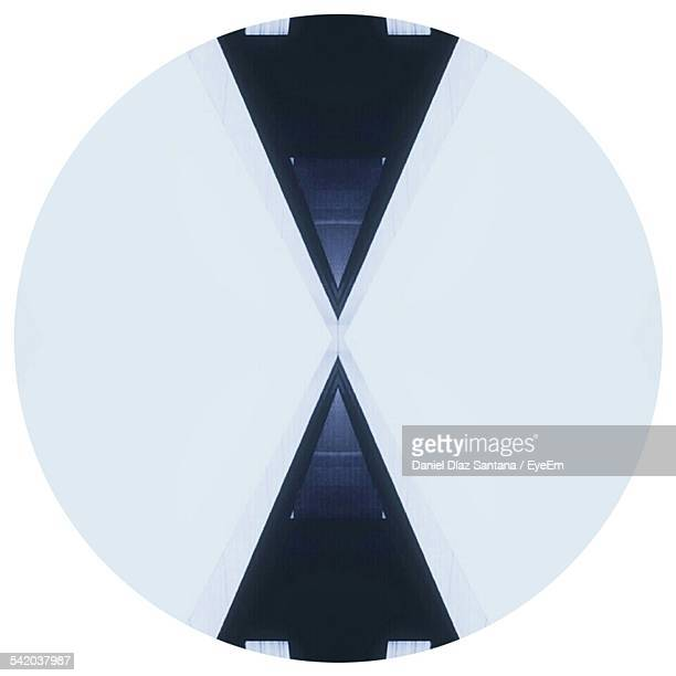 Circular Object With Triangle Shapes Against White Background
