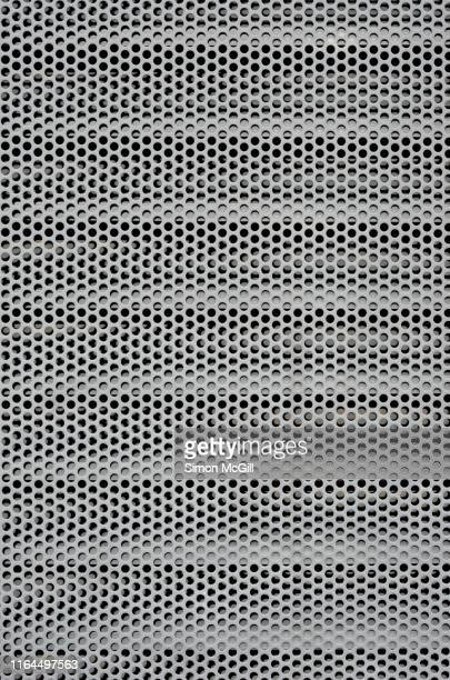 circular perforated steel mesh cover over air conditioning vents - wire mesh stock pictures, royalty-free photos & images