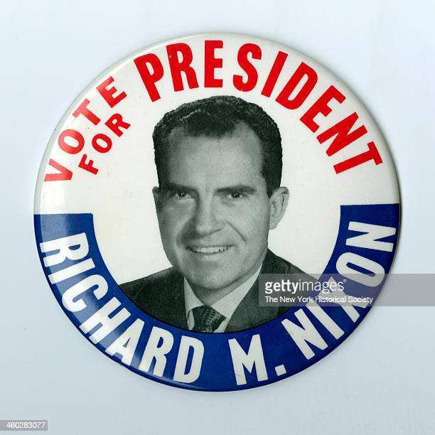 Circular pin back button with central photograph of Nixon surrounded with circular inscription in red white and blue 1968 Inscribed 'VOTE FOR...