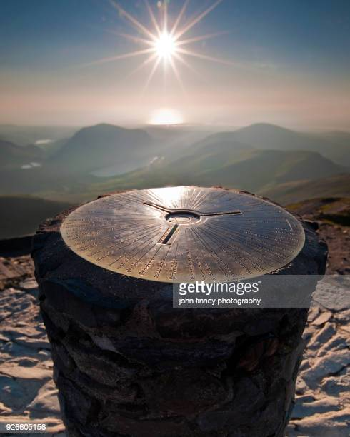 Circular plate on top of Snowdon Mountain summit trig point, Wales, UK