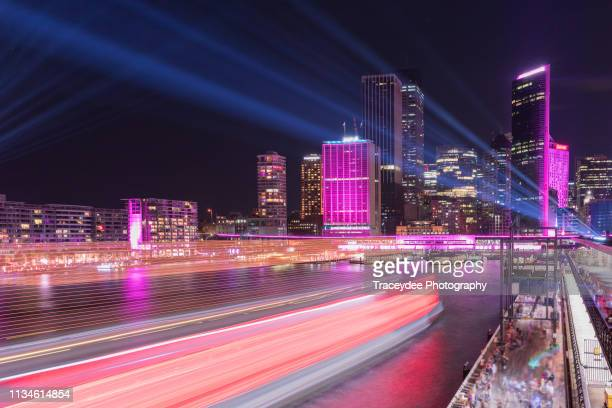 circular quay in sydney with ferries coming into the ferry terminal. - sydney harbour stock pictures, royalty-free photos & images