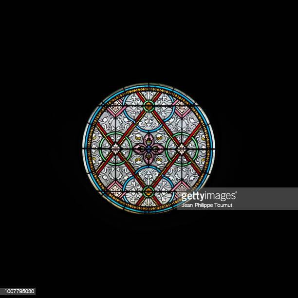 circular stained glass window of the church of carolles, normandy, france - stained glass stock pictures, royalty-free photos & images