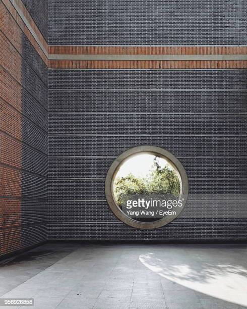 circular window on brick wall - suzhou stock pictures, royalty-free photos & images