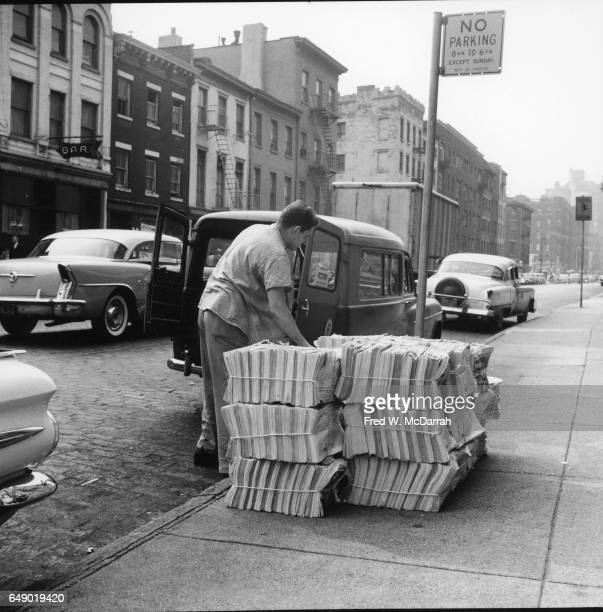Circulation manager and automobile columnist for the Village Voice weekly newspaper Dan List unloads the week's print run outside the paper's office...