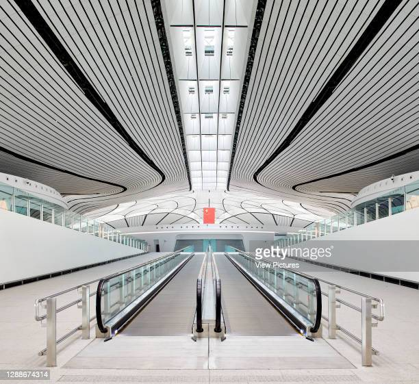 Circulation space with skylight and travelator. Beijing Daxing International Airport, Daxing, China. Architect: Zaha Hadid Architects, 2019.