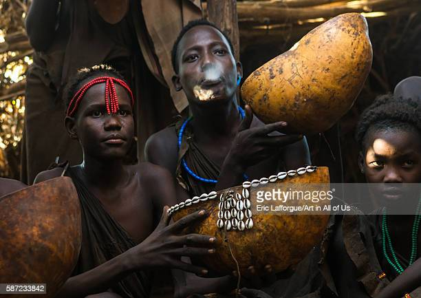 Circumcised boys from the dassanech tribe spitting to bless the visitors, omo valley, omorate, Ethiopia on March 16, 2016 in Omorate, Ethiopia.