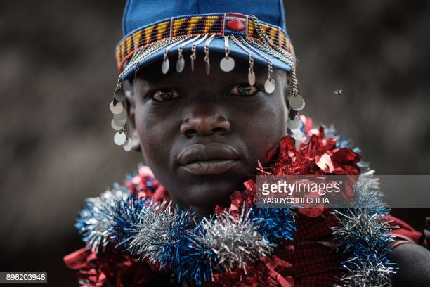 TOPSHOT A circumcised Maasai young man poses after coming out from the bush near Kilgoris Kenya on the last day of the annual onemonthlong...