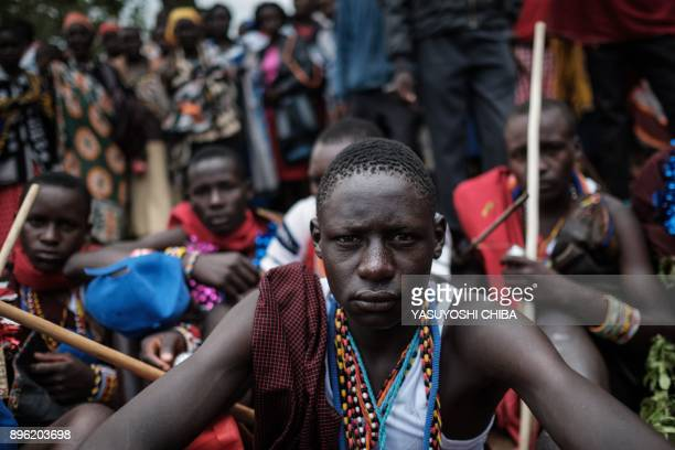 TOPSHOT Circumcised Maasai young men wearing new cloths and accessories come out from the bush near Kilgoris Kenya on the last day of the annual...