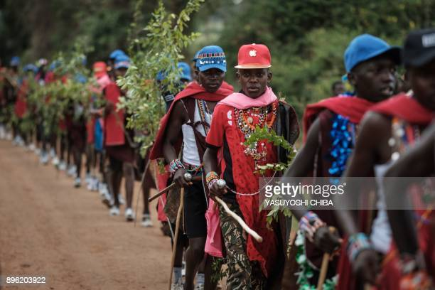 Circumcised Maasai young men wearing new cloths and accessories come out from the bush near Kilgoris Kenya on the last day of the annual onemonthlong...