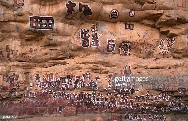 circumcision ceremonial paintings on cliff at songo village, dogon country, mali - circumcision stock pictures, royalty-free photos & images