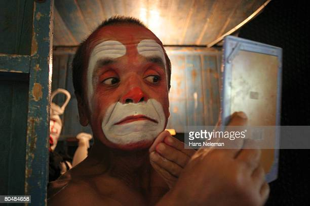 Circus actor doing make up