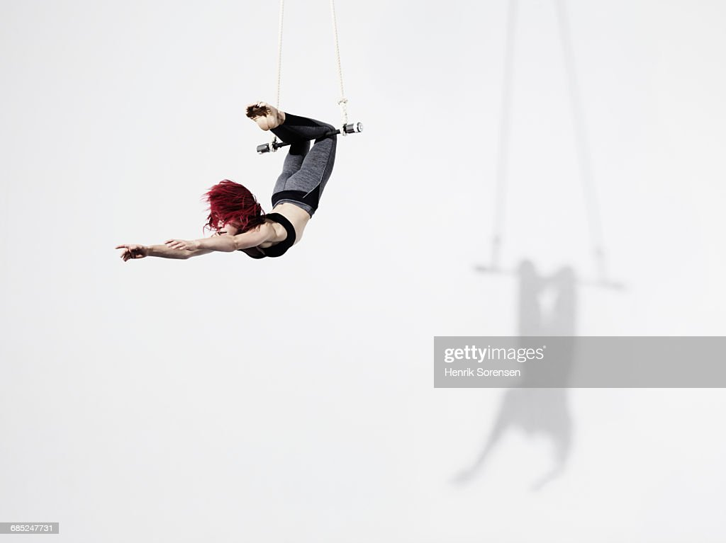Circus artist in Trapeze : Stock Photo