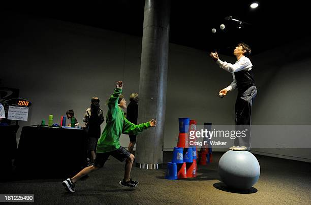 Circus artist Sven Jorgensen gets help juggling from Dayton Fisher during the opening day celebration at the History Colorado Center in Denver CO...