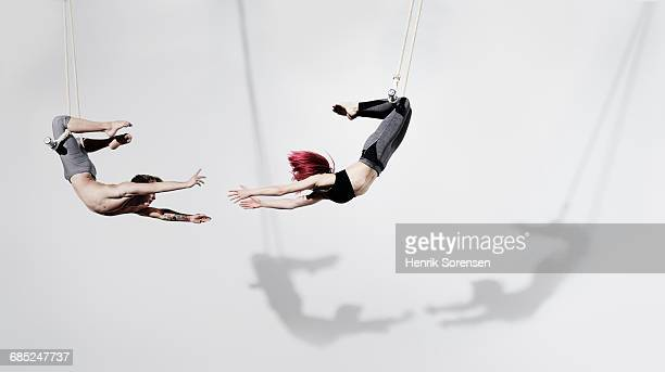 circus artists in trapeze - man made object stock pictures, royalty-free photos & images