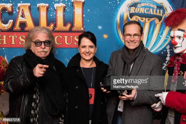 Circus director Bernhard Paul the Mayor of Berlin Michael Mueller his wife Claudia and a clown attend the 14th Roncalli Christmas at Tempodrom on...