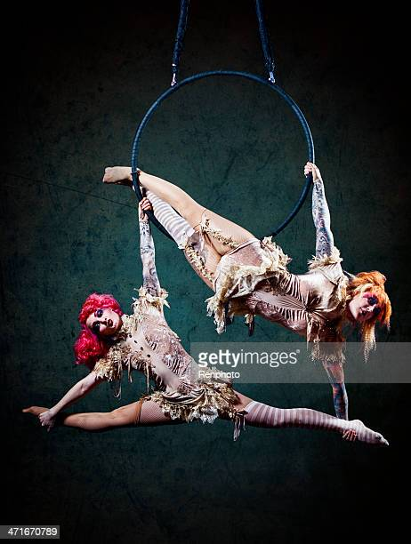 circus hoop performers - circus stock pictures, royalty-free photos & images