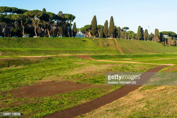 circus maximus is an ancient roman chariot racing stadium and mass entertainment venue located in rome, italy. - chariot racing stock photos and pictures
