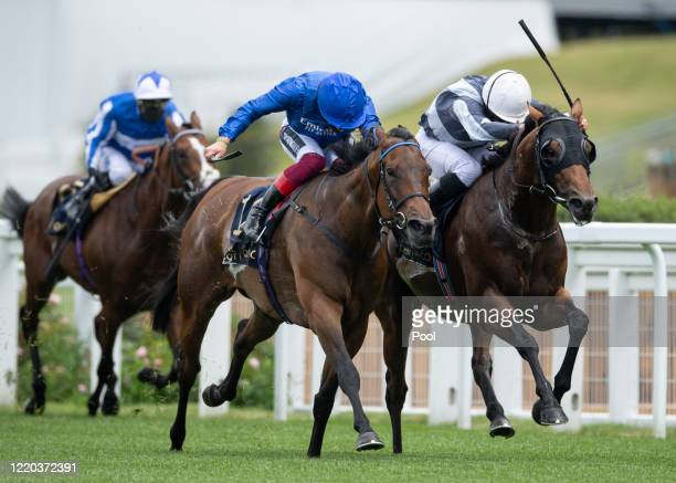 Circus Maximus ridden by Ryan Moore right battles with Terebellum ridden by Frankie Dettori before winning the Queen Anne Stakes at Ascot Racecourse...