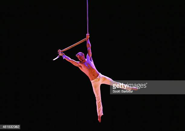 Circus performer Lucas Simonds performs an aerial straps routine at the National Institute of Circus Arts 'ROUGE et BLANC' media call on July 1 2014...