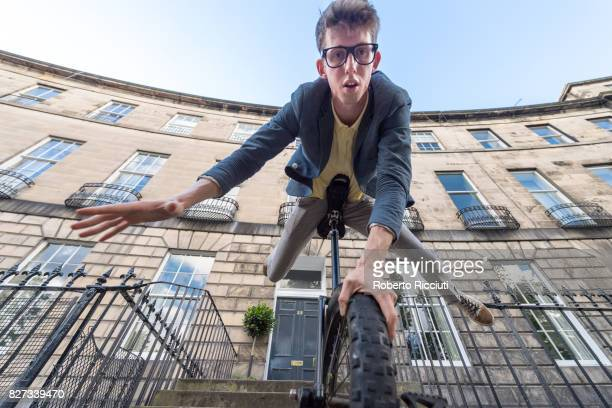 Circus performer Sam Goodburn performs on a unicycle during a photocall for his show 'Sam Goodburn Dumbstruck' at Royal Circus during the 70th...