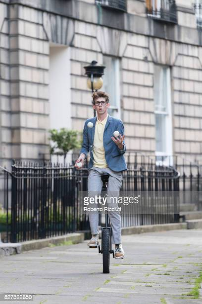 Circus performer Sam Goodburn performs on a unycicle during a photocall for his show 'Sam Goodburn Dumbstruck' at Circus Place during the 70th...