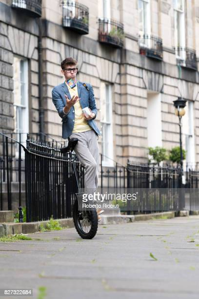 Circus performer Sam Goodburn performs on a unycicle during a photocall for his show 'Sam Goodburn Dumbstruck' at Royal Circus during the 70th...