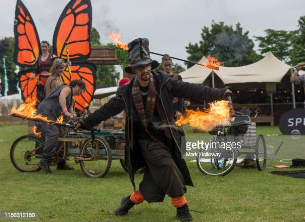 Circus performer with a flamethrower back stage at Isle of Wight Festival 2019 at Seaclose Park on June 16 2019 in Newport Isle of Wight