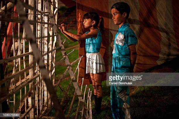 Circus performers from the Jan Baz troupe watch tthe show as they wait for their act on July 21 2010 in Islamabad Pakistan The Jan Baz Circus is...