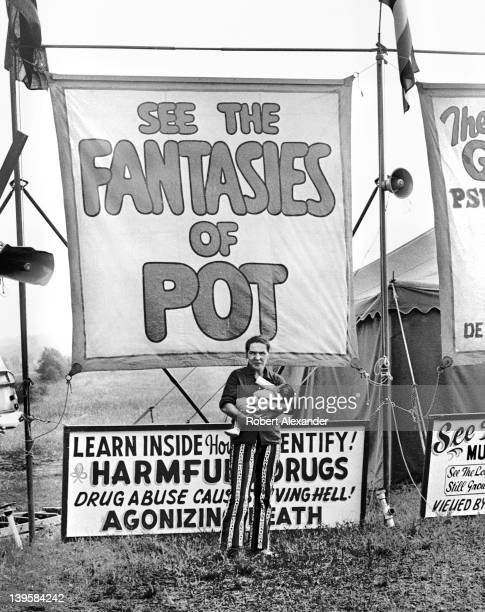Circus rides and sideshows advertising See the Fantasies of Pot and JoAnn the Double Sex Wonder attracted customers during a stop in the small...