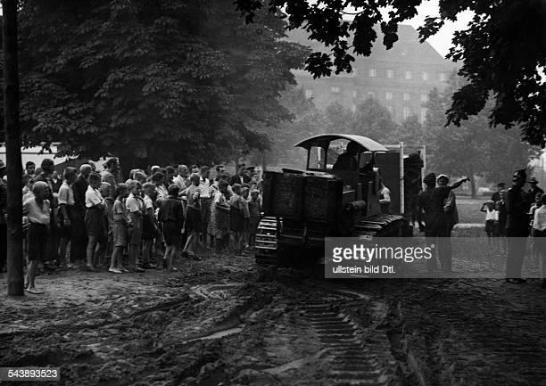 Circus Sarrasani series bulldozer an crowd of children Photographer Curt Ullmann Published by 'Hier Berlin' 19/1936Vintage property of ullstein bild