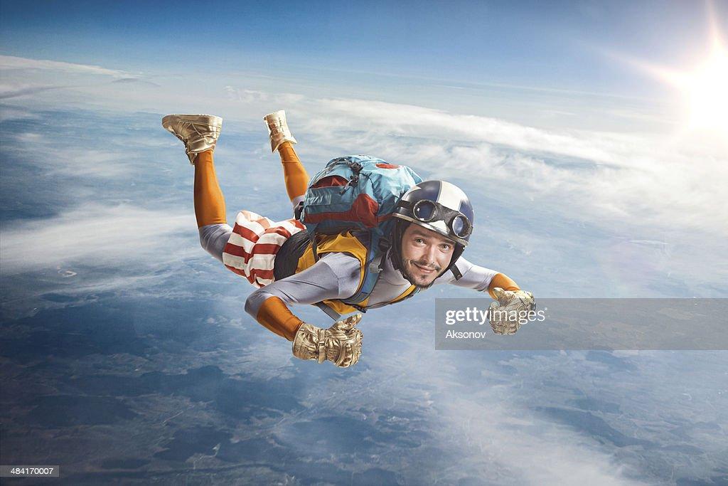 Circus skydiver falls through the air. : Stock Photo