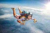Circus skydiver falls through the air.